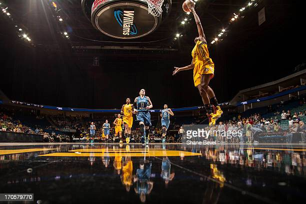 Candice Wiggins of the Tulsa Shock shoots a layup on a breakaway during the WNBA game against the Minnesota Lynx on June 14 2013 at the BOK Center in...