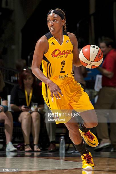 Candice Wiggins the Tulsa Shock dribbles the ball during the WNBA game against the Minnesota Lynx on June 14 2013 at the BOK Center in Tulsa Oklahoma...