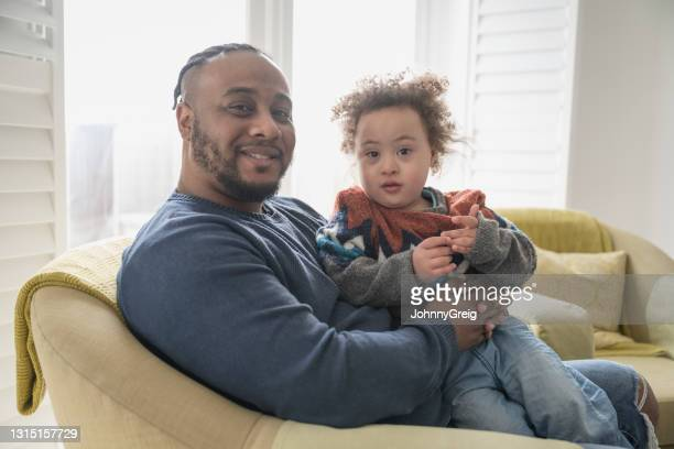 candid at-home portrait of mid 30s father and 4 year old son - genderblend stock pictures, royalty-free photos & images