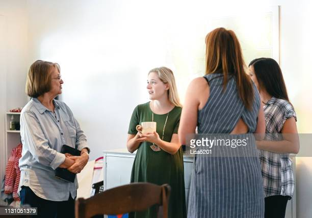 candid cheerful casual women at a informal meeting or gathering - local religioso imagens e fotografias de stock