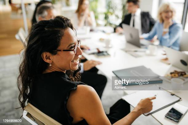 candid close-up of hispanic businesswoman in office meeting - candid stock pictures, royalty-free photos & images