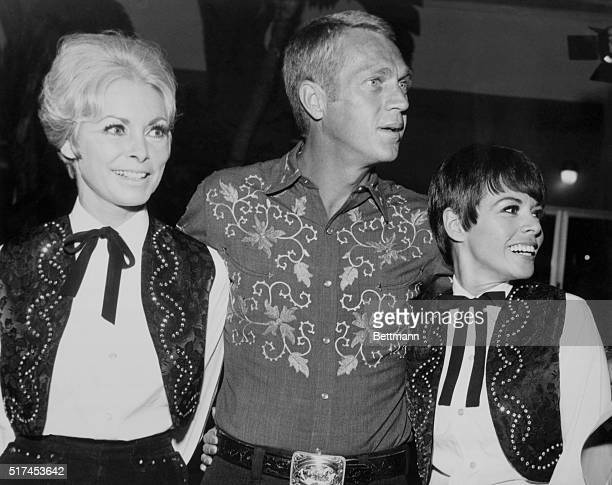 Shades of the old west pardners Janet Leigh stops to chat with Steve McQueen and his wife Neile Adams Business in cowboy and cowgirl attire in...