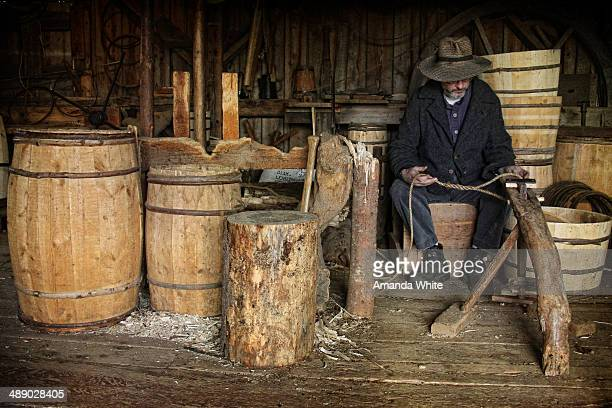 CONTENT] Candid interior image of a man at work in a Cooperage A cooperage is place where barrels were/are made to store all manner of items...