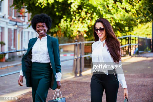 candid moments of happiness among friends - fashion collection stock pictures, royalty-free photos & images