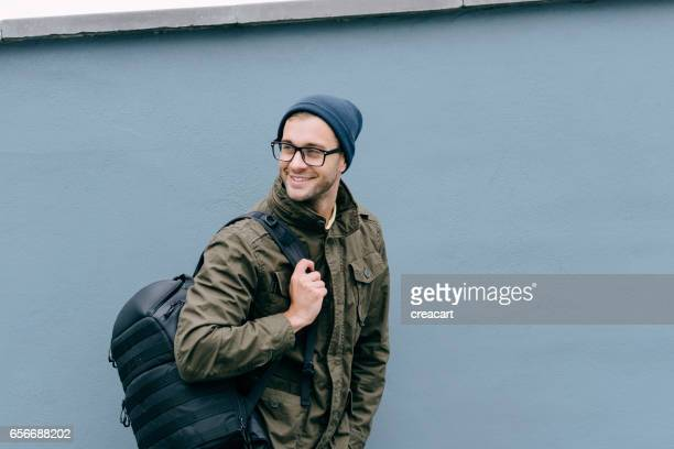 Candid outdoor Portrait of a Happy Man with backpack.