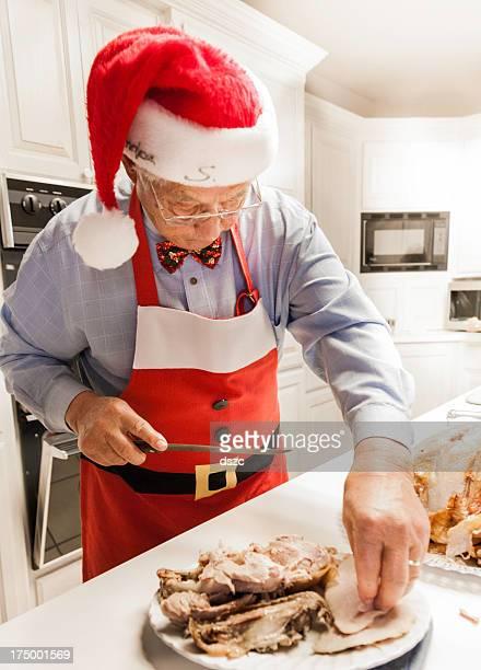 Candid photo of Grandpa Santa preparing Christmas dinner