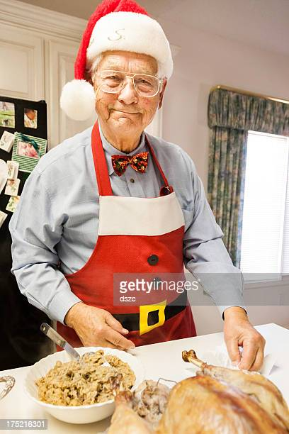 Candid photo of Grandpa Santa preparing Christmas dinner