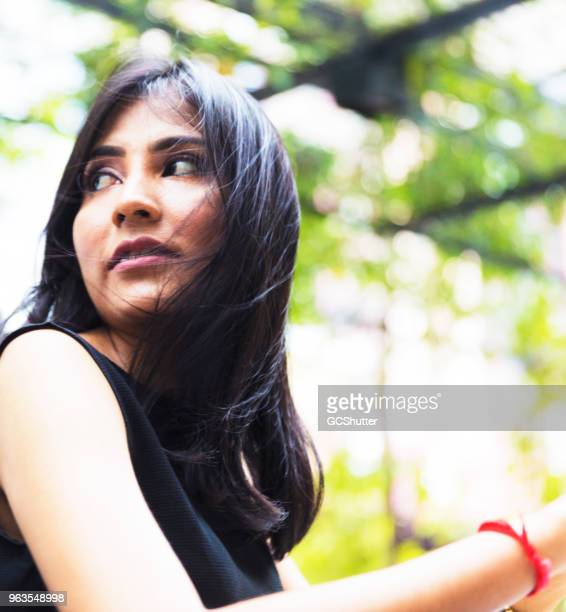 candid photograph of a young asian girl - malaysia beautiful girl stock photos and pictures