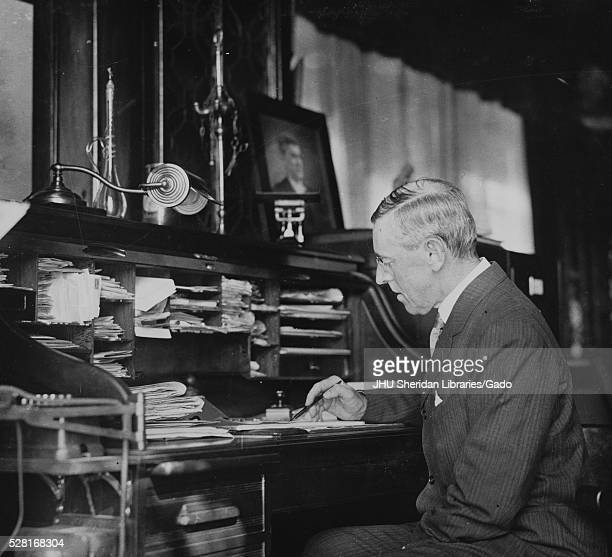 Candid photograph of Woodrow Wilson sitting at rolltop desk at Princeton University 1909