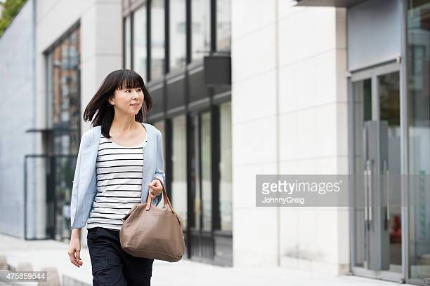 Candid portrait attractive Japanese woman in street