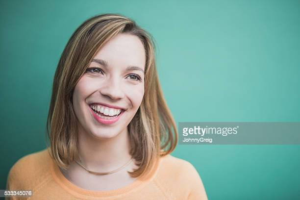 Candid portrait of a laughing and smiling young woman