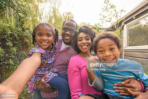 Candid portrait of African American family smiling