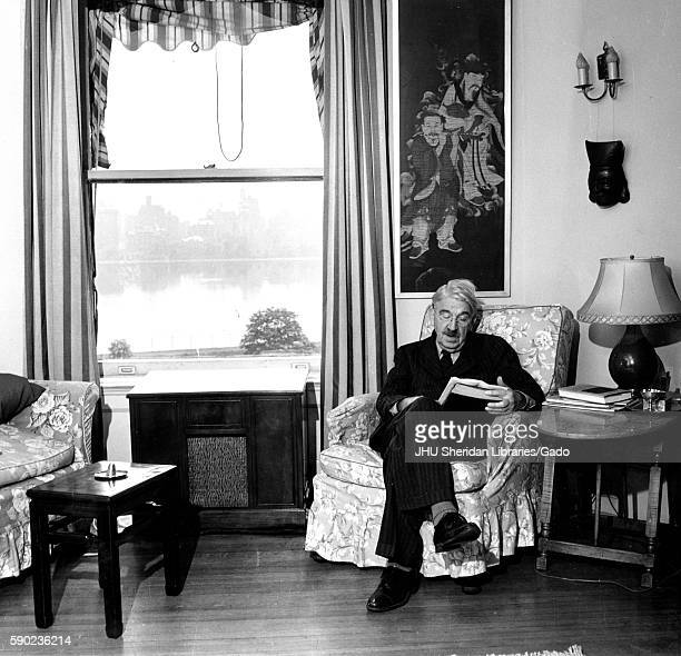 Candid portrait of American philosopher psychologist and educational reformer John Dewey sitting in his home reading 1946