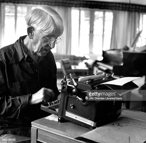 Candid portrait of American philosopher psychologist and educational reformer John Dewey sitting at a typewriter 1946