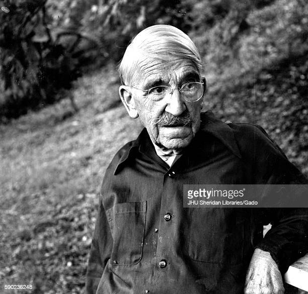 Candid portrait of American philosopher psychologist and educational reformer John Dewey standing in a wooded area 1935
