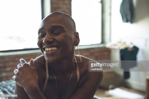 candid portrait of an afro american woman - hair loss stock pictures, royalty-free photos & images