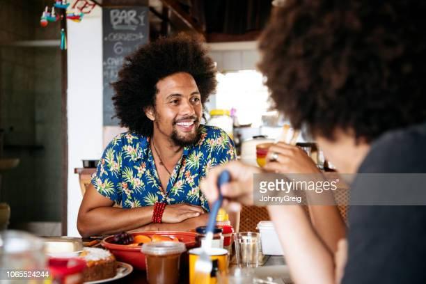 Candid portrait of Brazilian man smiling breakfast
