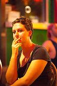 candid portrait caucasian tourist woman sitting