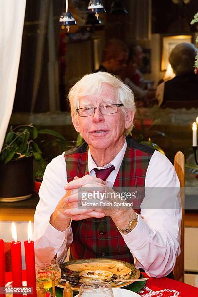 Candid portrait of elderly Norwegian man during Christmas celebrations at his home