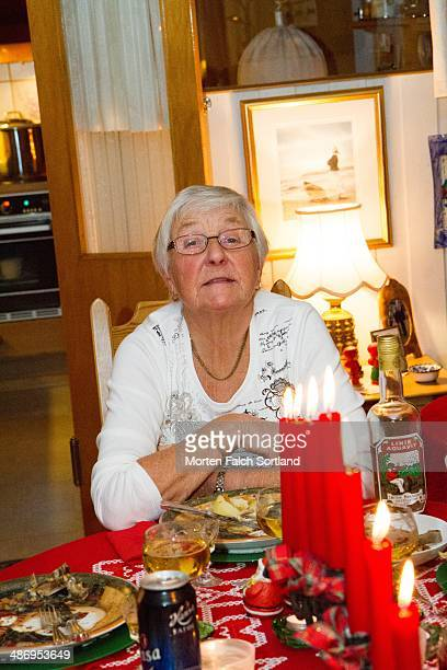 Candid portrait of elderly Norwegian woman during Christmas celebrations at her home