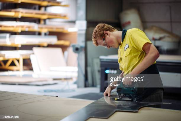candid portrait of engineer working in factory - employment law stock photos and pictures