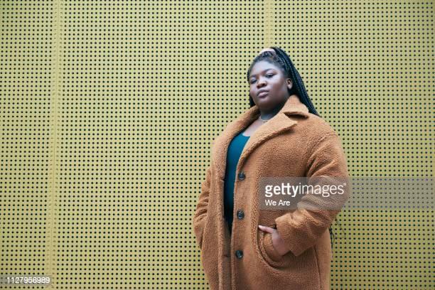 candid portrait of fashionable young woman. - fleecejas stockfoto's en -beelden