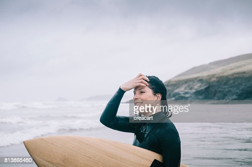 Candid Portrait of Female Surfer, Overcast rainy day, Cornwall.
