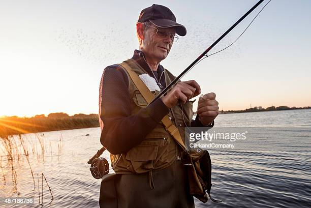 Candid Portrait of Fly Fisherman Tying a Fly