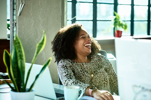 Candid portrait of mixed race professional woman laughing - gettyimageskorea