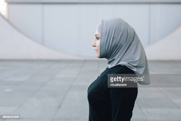 candid portrait of muslim woman. - headscarf stock pictures, royalty-free photos & images
