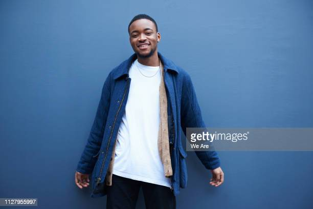 candid portrait of young fashionable man. - 20 24 years stock pictures, royalty-free photos & images