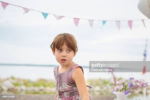 Candid portrait of young girl at party