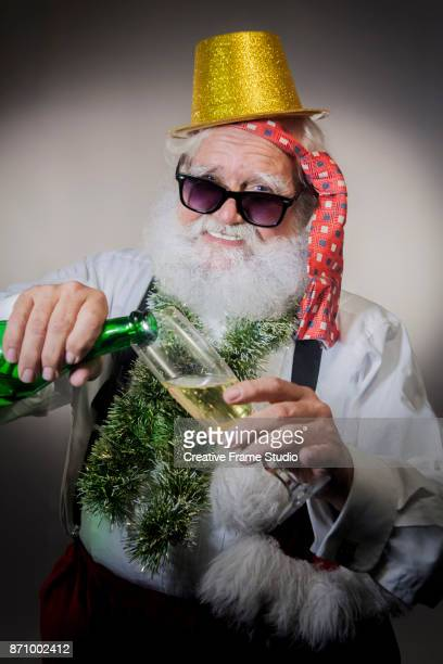 Candid Santa Claus serving champagne on a party.