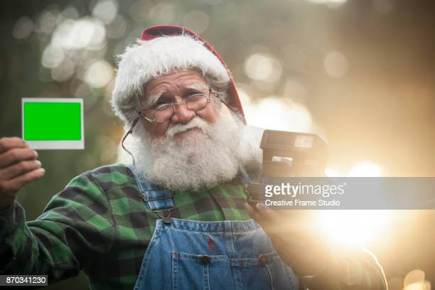 Candid Santa Claus showing a photo taken with an instant camera