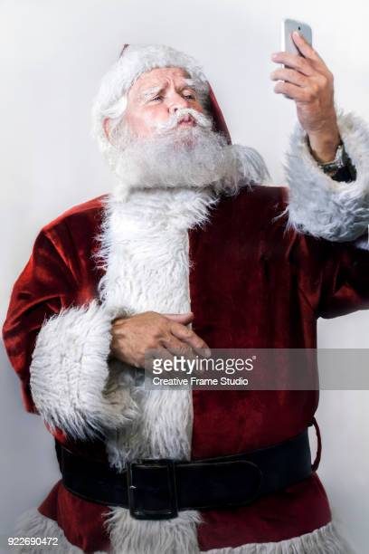Candid Santa Claus using a smartphone - selfie - video call