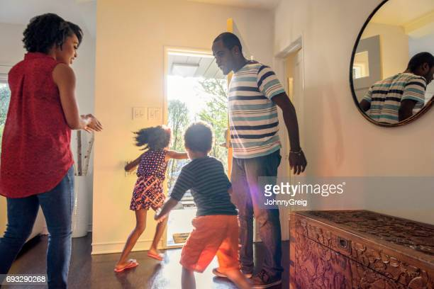Candid shot of African American family in hallway