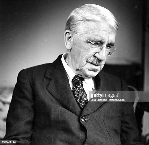 Candid sitting portrait of American philosopher psychologist and educational reformer John Dewey 1946