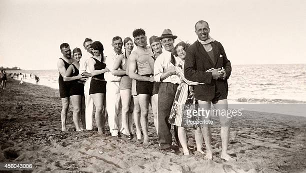 A candid snapshot featuring members of the England and Australia cricket teams and their partners enjoying a day at the beach in Queensland during...