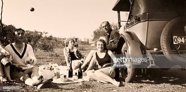 A candid snapshot of England cricketers Wally Hammond and George Geary and their partners enjoying a picnic in Queensland during the England cricket...