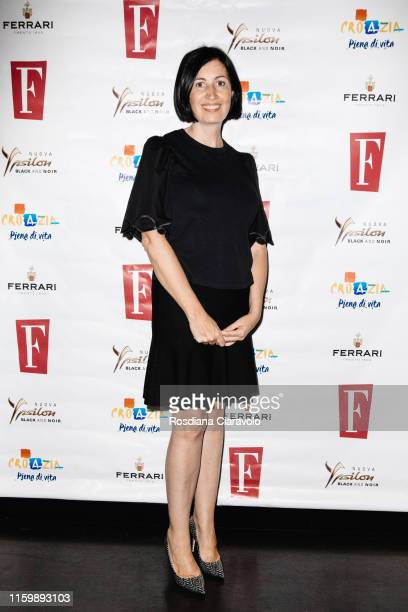 Candida Morvillo attends the F Magazine Party at Filippo La Mantia Oste e Cuoco restaurant on July 03, 2019 in Milan, Italy.