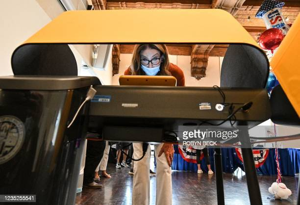 Candidate Caitlyn Jenner casts her ballot in the California gubernatorial recall election at a polling station in Beverly Hills, California,...