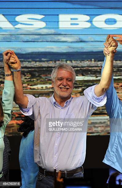 Candidate Enrique Penalosa celebrates after being elected Bogota's mayor on October 25 in Bogota Colombians went to the polls Sunday to elect...