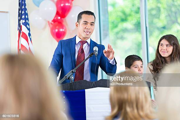 candidate for city government answering questions during speech - town hall meeting stock photos and pictures