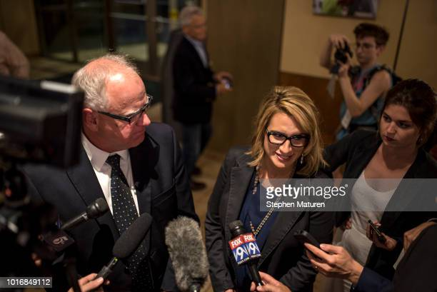 Rep Tim Walz stands on stage at an election night party with his wife Gwen Walz son Gus Walz and daughter Hope Walz on August 14 2018 in St Paul...