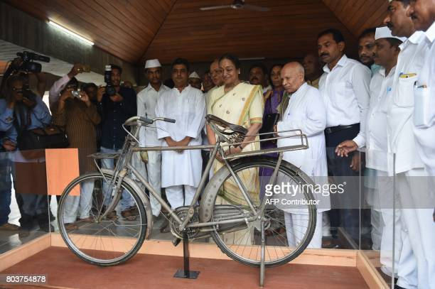 Candidate for Indian president Meira Kumar admires a bicycle once used by Indian independence icon Mahatma Gandhi during her visit to the Gandhi...