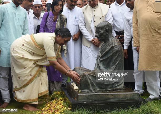 Candidate for Indian president Meira Kumar pays respects at a statue of Indian independence icon Mahatma Gandhi during her visit to the Gandhi Ashram...