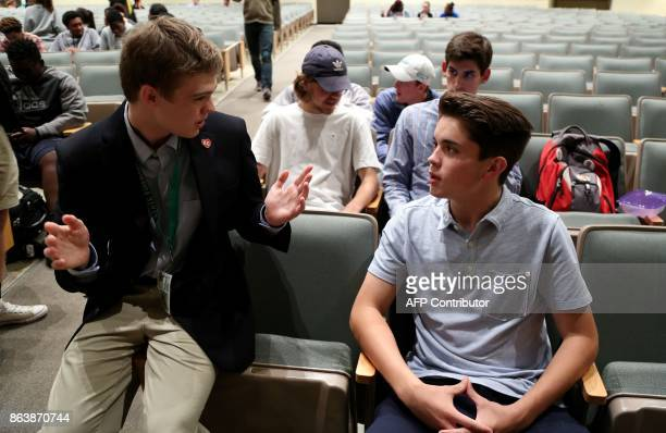 Candidate for Kansas Governor Tyler Ruzich of Prairie Village Kansas talks to Free State High School student Will Cook during a forum with the three...