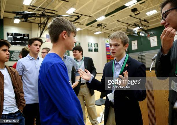 Candidate for Kansas Governor Tyler Ruzich of Prairie Village Kansas talks to students during a forum with the three other teenage candidates for...