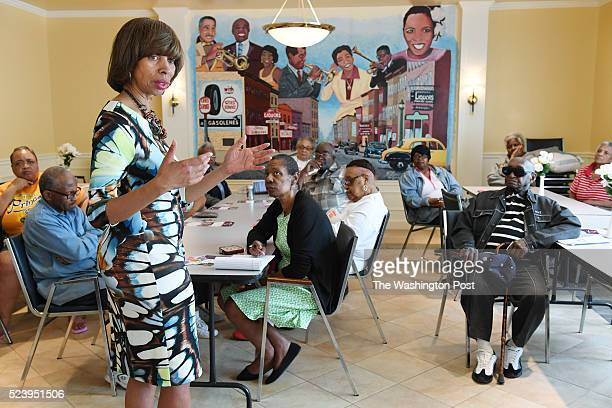 Candidate for mayor Catherine Pugh left talks to people at Zion Towers on Thursday April 21 2016 in Baltimore MD The city saw unrest following the...