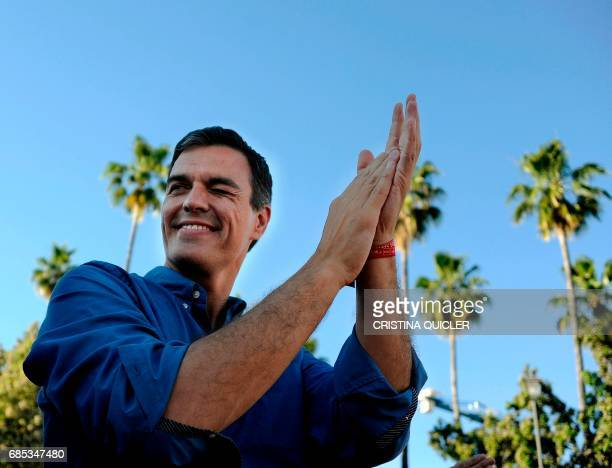 Candidate for Secretary General of the Spanish Socialist Party Pedro Sanchez winks as he claps during a political meeting with supporters at Muelle...